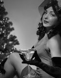 Superstar posing. Woman sitting near a Christmas tree Stock Photos