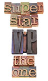 Superstar, VIP and the one. Superstar, VIP (very important person)  acronym and the one  - collage of isolated words in vintage wood letterpress printing blocks Royalty Free Stock Images