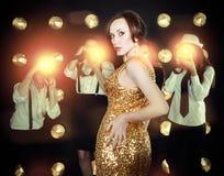 Superstar woman posing to paparazzi. Superstar women wearing golden shining dress posing to paparazzi Stock Photography