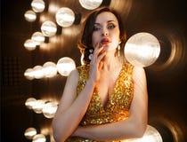 Superstar woman wearing golden shining dress Royalty Free Stock Images