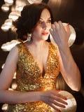 Superstar woman wearing golden shining dress Royalty Free Stock Photography