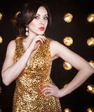 Superstar woman wearing golden shining dress Stock Image