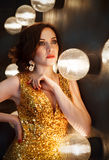 Superstar woman wearing golden shining dress Royalty Free Stock Photo