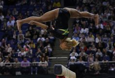 The Superstars of Gymnastics. LONDON, ENGLAND - MARCH 23 2019: Danusia Francis of Jamaica performs on the beam during the Superstars if Gymnastics at The O2 stock photography