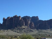 Superstition Mountains. Shadowed superstition mountains and blue cloudless Stock Photography