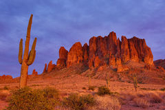 Superstition mountains at sunset. Superstition mountain engulfed in sunset light in the desrt of arizona Royalty Free Stock Image