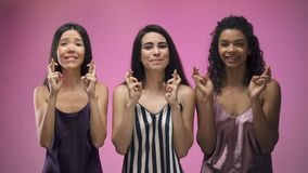 Superstitious ladies crossing fingers for good luck, dreams come true, hope. Stock footage stock footage