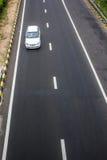 Superstrada bianca ad alta velocità dell'automobile Immagine Stock Libera da Diritti