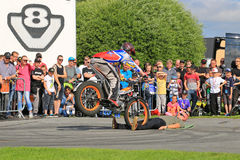 Supertrial Stunt Show by Tommi Ahvala. ALAHARMA, FINLAND - AUGUST 8, 2015: Tommi Ahvala entertain with the help of an unidentified male in a Supertrial Stunt Stock Images