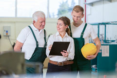 Supervision in manufacturing centre Stock Images