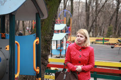 Supervision of a mother in amusement park Stock Image