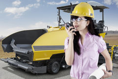 Supervisor with asphalt machine on the road Royalty Free Stock Images