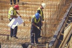 Supervisor with blueprint 6 Royalty Free Stock Image
