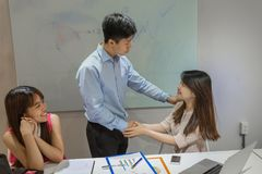 Supervisor congratulate his colleague on her promotion stock images