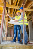 Supervisor of the construction site with architect on constructi. Supervisor of the construction site with architect looking building up on construction site Stock Photography