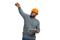 Supervisor de la construcción en el fondo blanco fotos de archivo