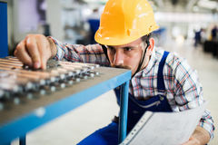 Supervisor doing quality control and pruduction check in factory Royalty Free Stock Photo