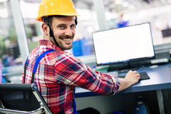Supervisor doing quality control and pruduction check in factory Stock Image