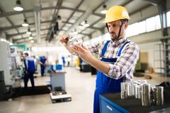 Supervisor doing quality control and pruduction check in factory. Supervisor doing quality control and pruduction check in metal factory Stock Image