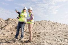 Supervisor examining construction site against sky Stock Photos