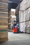 Supervisor Examining Stockpile At Warehouse Stock Image