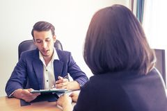 Supervisor explaining documents contractto a female worker. Supervisor is explaining documents to a female worker stock photography