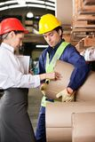 Supervisor And Foreman Checking Cardboard At Royalty Free Stock Photos