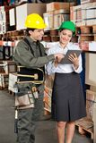 Supervisor And Foreman Using Digital Tablet at Stock Photos