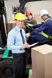 Supervisor With Foremen Working At Warehouse. Portrait of supervisor. This image has attached release Stock Photo