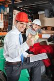 Supervisor And Forklift Driver Gesturing Thumbs Up Stock Image