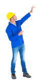 Supervisor with hand raised holding clipboard Stock Photography