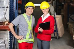 Supervisor Holding Clipboard Standing With Foreman Stock Image