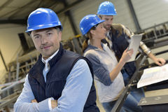 Supervisor in an industrial factory with employees Royalty Free Stock Photo