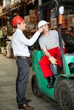 Supervisor Instructing Forklift Driver. At warehouse Royalty Free Stock Photography