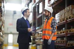 Supervisor Instructing Warehouse Worker royalty free stock image