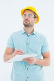 Supervisor looking away while writing on clipboard Royalty Free Stock Photography