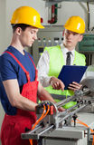 Supervisor and machine operator Royalty Free Stock Photography