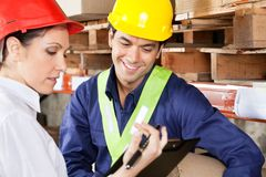 Supervisor Showing Clipboard To Foreman Royalty Free Stock Photos