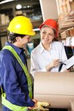 Supervisor Showing Clipboard To Foreman Royalty Free Stock Photography