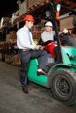 Supervisor Showing Clipboard To Forklift Driver Stock Photography