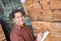 Supervisor Stock Taking In Warehouse. Portrait of a male supervisor stock taking in warehouse Royalty Free Stock Image