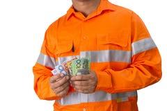 Supervisor u hombre del trabajo con la alta tenencia de la camisa de la visibilidad y c Imágenes de archivo libres de regalías