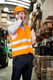 Supervisor Using Cell Phone At Warehouse. Portrait of young male supervisor using cell phone at warehouse Stock Image