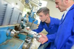 Supervisor watching apprentice engineer. Apprentice royalty free stock photos
