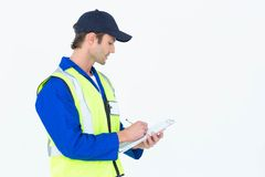 Supervisor writing notes on clipboard. Handsome supervisor writing notes on clipboard over white background Stock Images