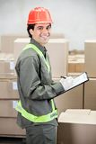 Supervisor Writing Notes At Warehouse. Portrait of young supervisor writing notes at warehouse Royalty Free Stock Photos