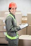 Supervisor Writing Notes At Warehouse Royalty Free Stock Photos