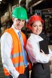 Supervisores novos seguros no armazém Fotografia de Stock Royalty Free