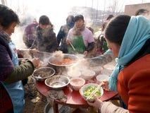 Supervisori culinari pieghi della Cina nella cottura Fotografie Stock