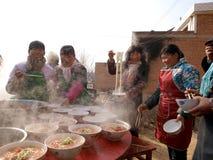 Supervisori culinari pieghi della Cina nella cottura Fotografie Stock Libere da Diritti